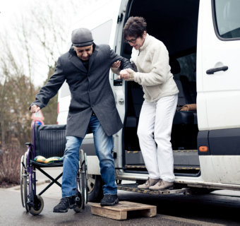 senior couple unloading on a van