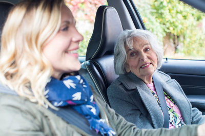 Female Neighbor Gives Senior Woman A Lift In Car
